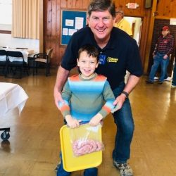 Clark and his helper supporting the Olney Lions Club